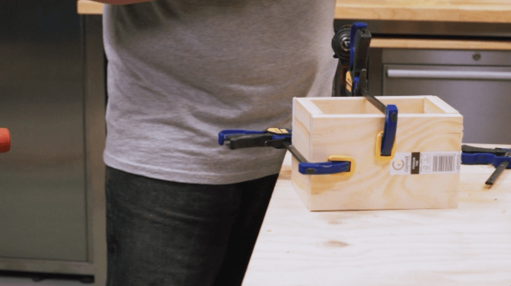 Using clamps to hold a timber square