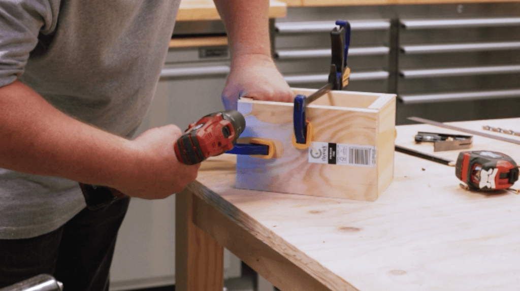 Using a cordless drill to make pilot holes