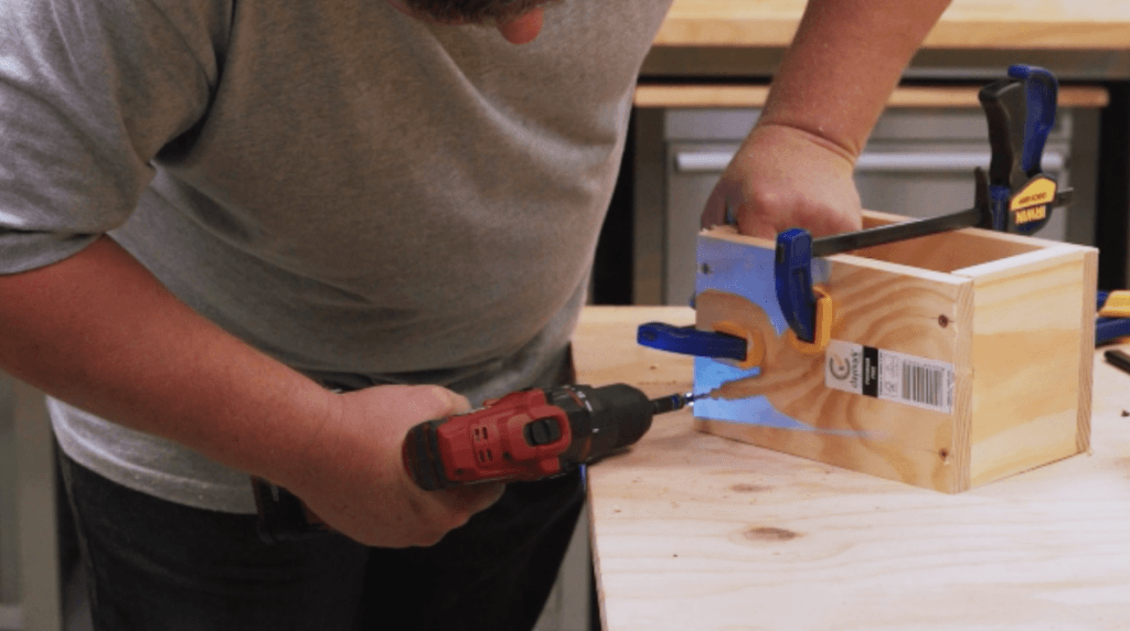 Using a cordless drill to drive screws