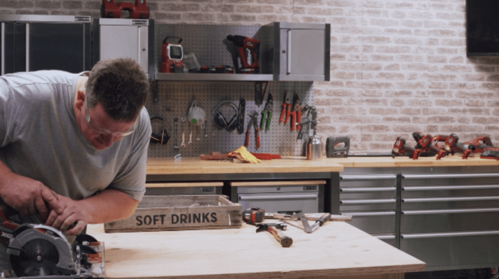 Circular saw cutting wooden drinks crate
